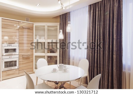 Modern kitchen interior with white dining table and four chairs