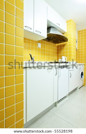 Modern kitchen interior with yellow walls