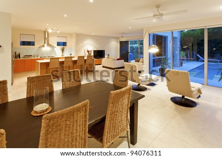 Modern kitchen, living room and dining table