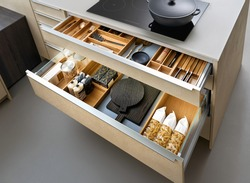 Modern kitchen, Open drawers, Set of cutlery trays in kitchen drawer. Solid oak wood cutlery drawer inserts.