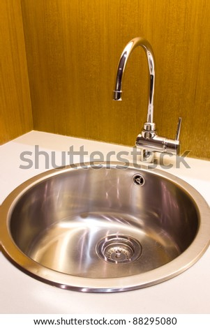 modern kitchen sink with stainless steel basin