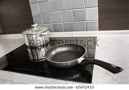 Modern kitchen. Steel pot and pan on the induction cooker