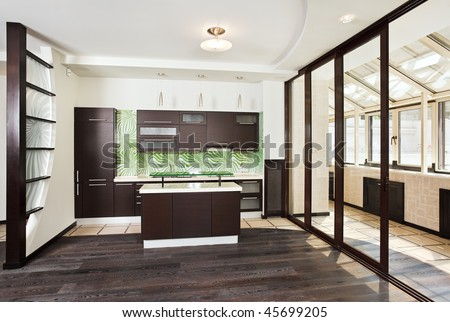 Modern kitchen (studio) interior with balcony and dark Wooden floor, front wide angle view