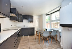 modern Kitchen White Marble worktop and Grey Gloss Units and tiled flooring  design idea London UK