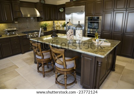 Modern kitchen with a tile floor and granite island.