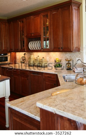 Modern Kitchen With Cherry Cabinets And Granite Counter Tops Stock
