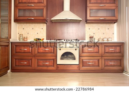 Modern Kitchen with Cherry drawers and Granite Countertops - stock photo