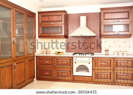 Modern Kitchen With Cherry Drawers And Granite Countertops Stock ...