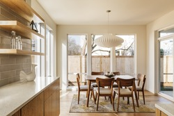Modern Kitchen with dinning are and stylish furniture.