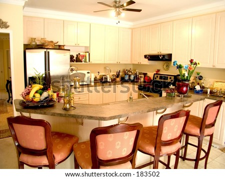 kitchen island table with 4 chairs modern kitchen with island table four chairs fridge stove and ceiling fan stock photo 183502 8061