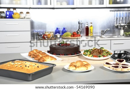 Modern kitchen with many various dishes and prepared food - stock photo