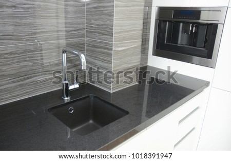 Modern kitchen with Modern Faucet, sink and coffee machine #1018391947