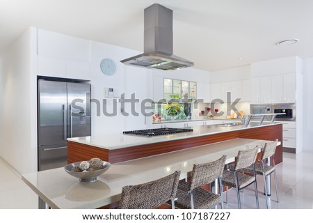 Modern kitchen with stainless steel appliances in Australian mansion - stock photo