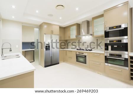 Modern kitchen with stainless steel appliances in Australian mansion #269469203