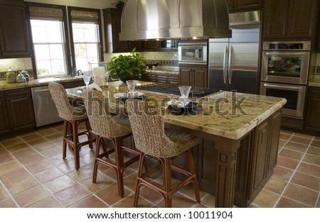 Modern kitchen with tile floor and island.
