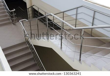 Modern ladder with a metal hand-rail. Stairway