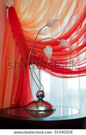 Modern lamp on a background of an red curtain