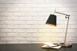 Modern lamp on the desk on white wall background
