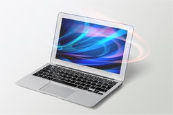Modern laptop computer with a blank screen on the desk