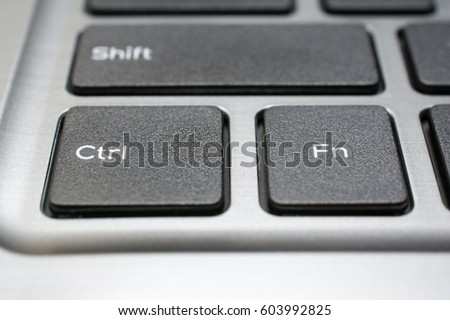 Modern laptop keyboard closeup. Ctrl and Fn key. Shallow depth of field. #603992825