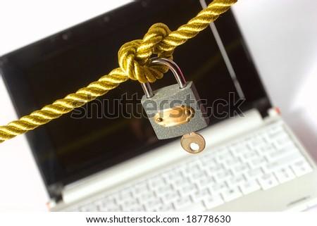 Modern laptop locked with padlock