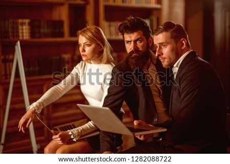 Modern life concept. Woman and men use laptops in modern life. Modern life with new technology. Modern life in library. #1282088722