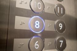 Modern Lift Button light on number eight