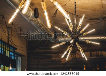Modern light chandelier at coffee shop, light bulbs  #1243585015