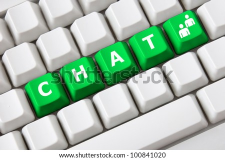 Modern light computer keyboard with a chat text and people symbol on buttons.Social media concept