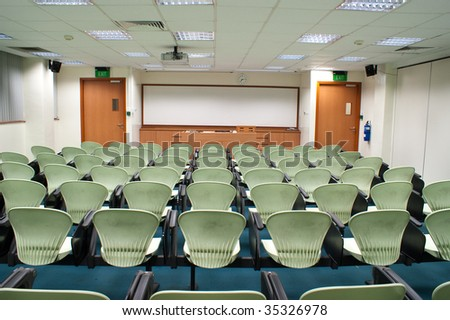 Modern light green Seat arrangement in University lecture room - stock photo