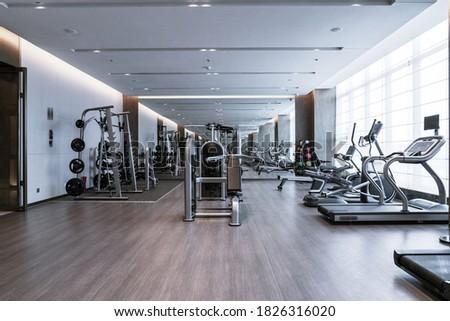 Modern light gym. Sports equipment in gym.  Stock photo ©