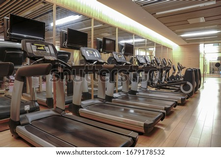Modern light gym. Sports equipment in gym. Barbells of different weight on rack. Foto d'archivio ©