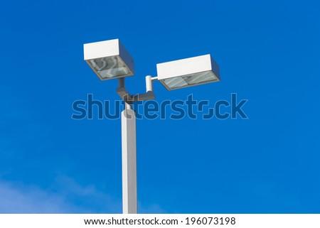 modern light pole with blue sky