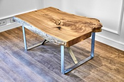 Modern live edge elm slab coffee table with inner knot in bizarre pattern shape and tree rings. Table top on metal support