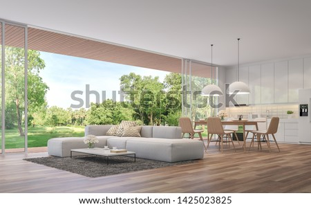 Modern Living, dining room and kitchen with garden view 3d render.The Rooms have wooden floors ,decorate with white furniture,There are large open doors. Overlooks wooden terrace and large garden.
