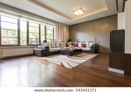 Modern living room design with brown parquet #543431371