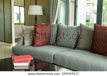 modern living room design with red pillows on sofa and lamp