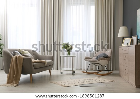 Modern living room interior with beautiful curtains on window Stockfoto ©