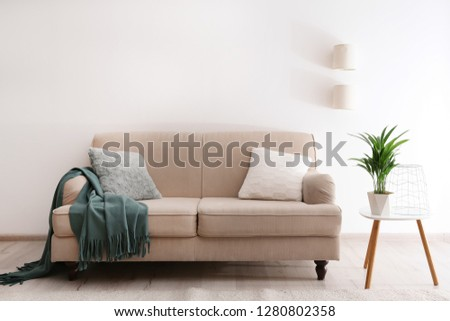 Modern living room interior with comfortable sofa #1280802358