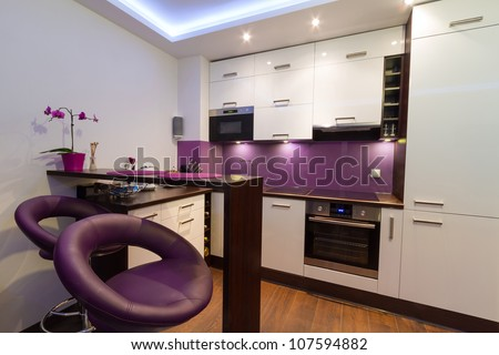 Modern living room interior with kitchen - stock photo