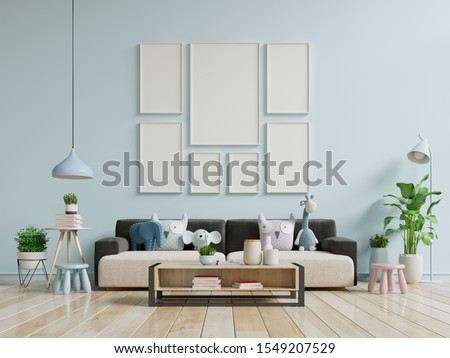Modern living room interior with sofa and green plants,lamp,table on blue wall background. 3d rendering