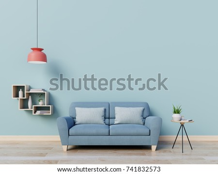 Modern living room interior with sofa   and green plants,lamp,table on blue wall background. 3d rendering.