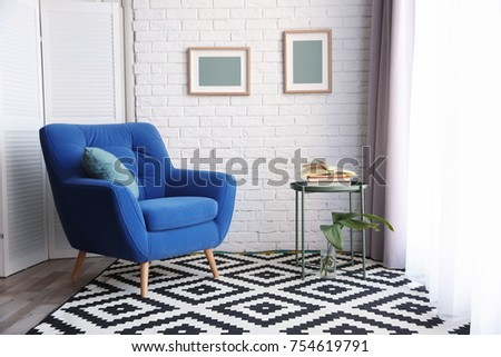 Modern living room interior with stylish armchair and carpet