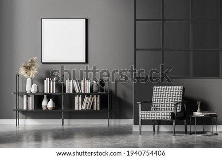 Modern living room interior with vintage armchair and coffee table, bookshelf with books and vase decoration, minimalist reading room with concrete floor. Blank mock up frame on wall, 3D rendering Photo stock ©