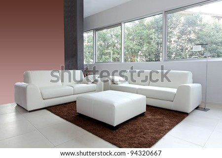 Modern living room interior with white furniture