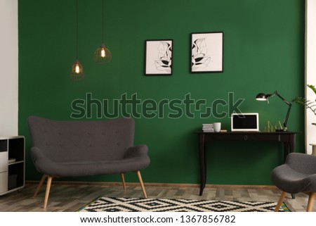 Modern living room interior with workplace near green wall #1367856782