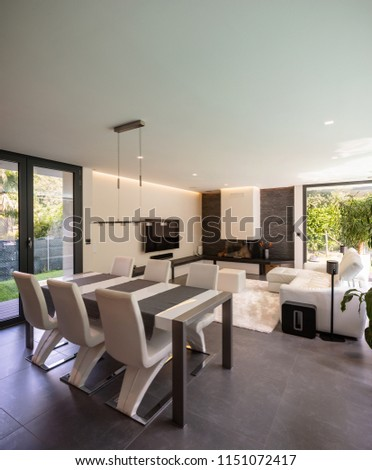 Modern living room overlooking the garden and swimming pool. Nobody inside #1151072417
