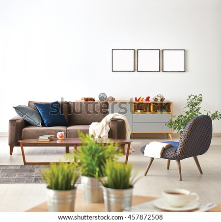 modern living room sofa and armchair with vase of grass