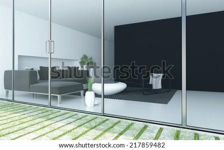 Modern living room viewed from a patio through a floor to ceiling glass wall or windows with an upholstered lounge suite and minimalist grey and white decor