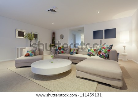 Modern living room with couch and round table in new Australian apartment